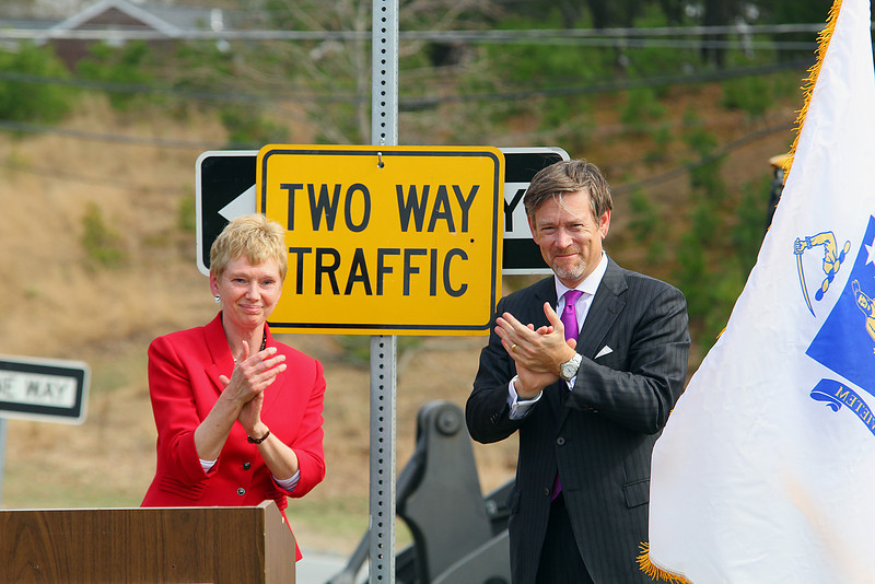MassDevelopment announced on Tuesday a $1.85 million dollar investment for the the phase 4, the final phase, of Devens Jackson Road redevelopment project.  President & CEO of MassDevelopment Marty Jones and Matt Erskine Deputy Assistant Secretary of U.S. Commerce for Economic Development hung a two way sign over the one way sign that will change that part of Jackson Road, during the event on Devens. SENTINEL & ENTERPRISE/JOHN LOVE