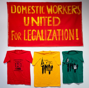 The walls of the room were decorated with real life posters and banners and the other paraphernalia of the union's struggle on behalf of hard-working domestic workers.