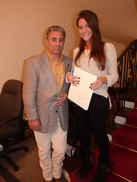 Intern Ilaria Martina Manzin with her clipboard poses with Gianni Lopez, who is in charge of the technical operations of the Italian Institute