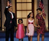 Democratic presidential nominee, Sen. Barack Obama, D-Ill., his wife, Michelle, and daughters Malia, 10, second from right, and Sasha, 7, wave after his acceptance speech at the Democratic National Convention in Denver, Thursday, Aug. 28, 2008.  (AP Photo/Ron Edmonds)