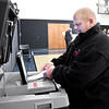Mark Konkle deposits his new paper ballot after voting at Wesley Free Methodist Church at 3017 W. 8th Street.