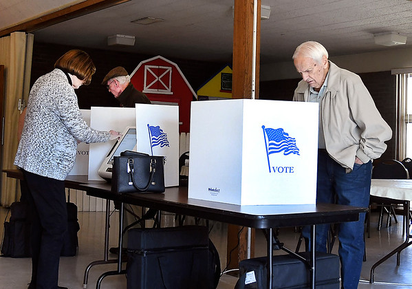 The new voting machines are smaller and sit on a table top then surrounded by a three-sided shield for privacy.