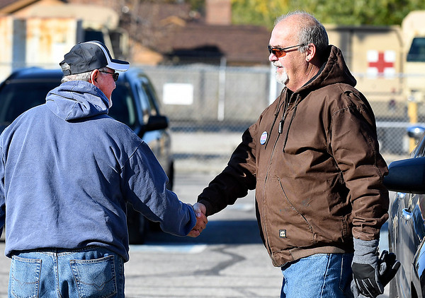 Tim Funk, right, Anderson City Council District 1 Democrat candidate, greets voters as he works the three precincts located at National Guard Armory Tuesday.