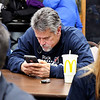 Republican mayoral candidate Rick Gardner keeps a close tabs on the election results on his phone from the county's website Tuesday evening as the republicans gathered at the Paramount Building for the election returns.