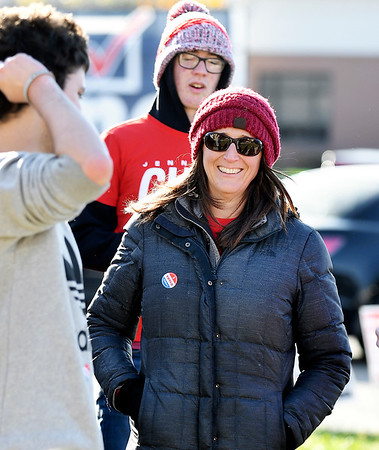 Republican Jennifer Culp, Anderson City Council District 1 incumbent, has a laugh with her supporters as they work the three voting precincts located at the National Guard Armory Tuesday.