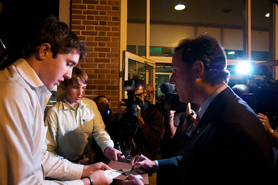 Oct. 11, 2011, Hanover, N.H. - Zach Hesketh, 16, left, of Granby, Conn. and his brother Andrew, 13, center, get presidential candidate Rick Santorum's autograph as he enters the Spaulding Auditorium at Dartmouth College before Tuesday night's Republican primary debate. The Heskeths drove to New Hampshire with a copy of each candidate's book for them to sign. By Ryan Hutton
