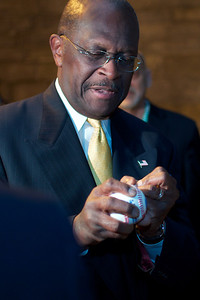 Oct. 11, 2011, Hanover, N.H. - Republican Presidential Candidate Herman Cain signs a baseball for Hanover High School student Gabe Brison, 17, before entering the Spaulding Auditorium at Dartmouth College, prior to Tuesday night's Republican primary debate. By Ryan Hutton