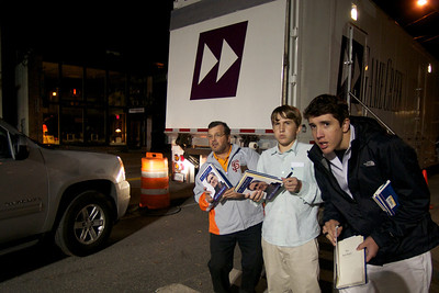 Oct. 11, 2011, Hanover, N.H. - Scott Hesketh of Granby, Conn., left, and his sons, Andrew, 13, center, and Zach, 16, right, try to locate some of the Republican presidential candidates as they leave the rear of the Spaulding Auditorium at Dartmouth College after Tuesday night's Republican primary debate. The Heskeths drove to New Hampshire with a copy of each candidate's book for them to sign. By Ryan Hutton