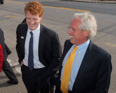 110612, Taunton, MA - Joe Kennedy II, right, and Joe Kennedy III, left, smile as they greet the younger Kennedy's congressional campaign supporters  outside the polls at the Westville Congregational Church. Photo by Ryan Hutton