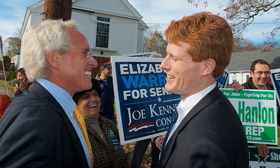 110612, Taunton, MA - Joe Kennedy II, left and Joe Kennedy III talk as they greet the younger Kennedy's congressional campaign supporters  outside the polls at the Westville Congregational Church. Photo by Ryan Hutton