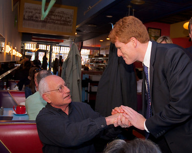 "110612, Newton, MA - Joe Kennedy greets supporters inside Johnny's Luncheonette on Langley Road on election day.  Here he shakes the hand of Newton resident Peter Demos, who reminded the young Kennedy that his uncle was ""the best!"". Photo by Ryan Hutton"