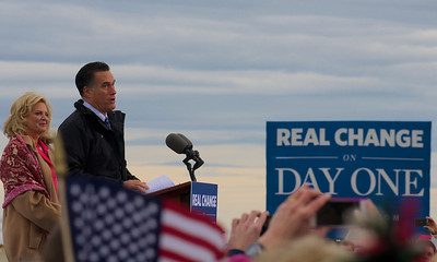 110312, Porthsmouth, NH - Presidential candidate Mitt Romney speaks to a crowd at a rally at Portsmouth International Airport on Saturday morning. Next to him is his wife Ann Romney. Photo by Ryan Hutton