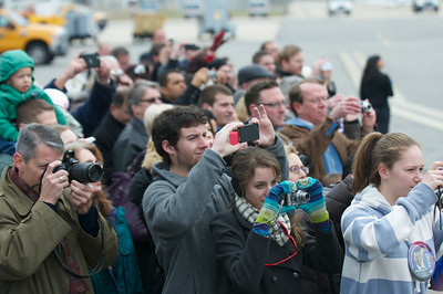 Nov. 22, 2011 Manchester, N.H. - Crowds of onlookers wait to get a picture of President Barack Obama as Air Force One sits on the tarmac of Manchester Airport. Obama was on his way to Manchester High School to give a speech on the American Jobs Act. By Ryan Hutton