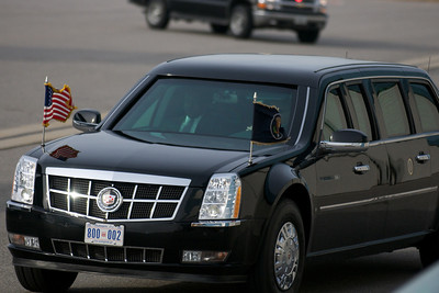 "Nov. 22, 2011 Manchester, N.H. - President Barack Obama returns to the tarmac of Manchester Airport in his armored Cadillac limousine nicknamed ""The Beast"", after giving a speech on the American Jobs Act at Manchester High School. By Ryan Hutton"
