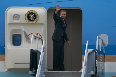 Nov. 22, 2011 Manchester, N.H. - President Barack Obama waves to the press as he boards Air Force One to depart Manchester Airport after giving a speech on the American Jobs Act at Manchester High School. By Ryan Hutton