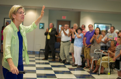 071512, Worcester, MA - Elizabeth Warren recieves a standing ovation from a crowd of supporters and independent voters after speaking at a campagin stop at the Teamsters Local 170 Hall in Worcester on Sunday. Herald photo by Ryan Hutton