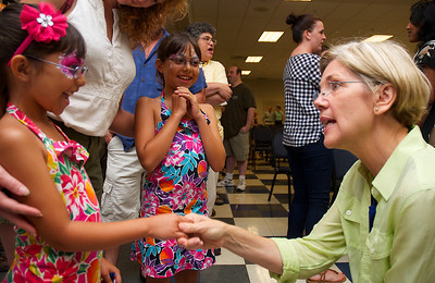 071512, Worcester, MA - Elizabeth Warren shakes hands with Marieanna Das, 6, of Westborough, left, as her older sister Mallika, 8, center, looks on at a campagin stop at the Teamsters Local 170 Hall in Worcester on Sunday. Herald photo by Ryan Hutton
