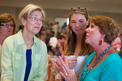 071512, Worcester, MA - Elizabeth Warren speaks to Jane Switchenko of Sturbridge, right, and her daughter Carolyne, center, at a campagin stop at the Teamsters Local 170 Hall in Worcester on Sunday. Herald photo by Ryan Hutton