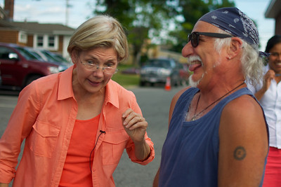 070312, Rutland, MA - Senatorial candidate Elizabeth Warren jokes around with constituant Fred Perrone during a campagin stop at the Rutland Chicken BBQ for the town's 4th of July celebrations. Herald photo by Ryan Hutton
