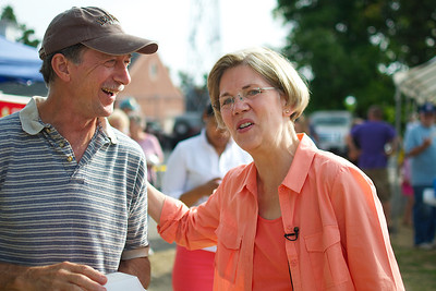 070312, Rutland, MA - Senatorial candidate Elizabeth Warren speaks with a constituant during a campagin stop at the Rutland Chicken BBQ for the town's 4th of July celebrations. Herald photo by Ryan Hutton