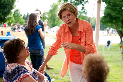070312, Rutland, MA - Senatorial candidate Elizabeth Warren speaks with constituants during a campagin stop at the Rutland Chicken BBQ for the town's 4th of July celebrations. Herald photo by Ryan Hutton