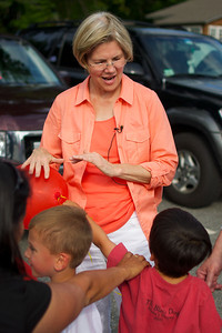 070312, Rutland, MA - Senatorial candidate Elizabeth Warren plays with a balloon given to her by a young constituant during a campagin stop at the Rutland Chicken BBQ for the town's 4th of July celebrations. Herald photo by Ryan Hutton