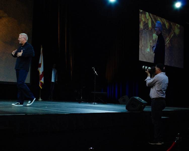 Photographer George Lange taking stage shots of Glenn Beck at a rehearsal for the event