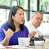 Steven Wallae the Town Planner for Westminster listens to Fitchburg's Mayor Lisa Wong as she address' the crowd at the final plan presentation for the Wachusett Smart Growth Corridor Analysis on Friday at CAN-AM Machinery in Fitchburg. SENTINEL & ENTERPRISE/JOHN LOVE
