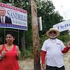 Senovia Sandrelli, wife of candidate Stephen Sandrelli, and Felix Philip Velasquez campaign during Fitchburg's preliminary mayoral election on Tuesday. SENTINEL & ENTERPRISE / Ashley Green