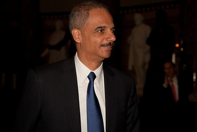 US Attorney General Eric Holder makes his way through the US Capitol Rotunda following the address of His Excellency Felipe Calderón Hinojosa, President of Mexico in Washington DC. on May 20, 2010. Calderon, the first foreign national leader to address Congress this year, said he strongly disagrees with the Arizona law that requires police to question people about their immigration status if there's reason to suspect they are in the country illegally. (Photo by Jeff Malet)