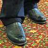 George has ALWAYS worn cowboy boots. ..VA. Attorney Gen. Ken Cuccinelli wears them also. His look about like George's. Except George's sole is seperating on the right toe. Love my Nikon.