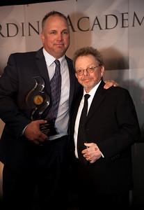 """Solo artist of the century Garth Brooks receives an award from Paul Williams at the Recording Academy sponsored GRAMMYS on the Hill reception and awards at the Liaison Capitol Hill Hotel in Washington DC on April 14, 2010. GRAMMYs on the Hill is called """"Washington's most interesting mix of music and politics."""" The two days of music advocacy connects top music makers with members of Congress in Washington, D.C., in an effort to inform policy makers of the important role the recording arts play in the nation's culture and economy, and to raise the profile of the recording arts during meetings with legislators. (Photo by Jeff Malet)"""