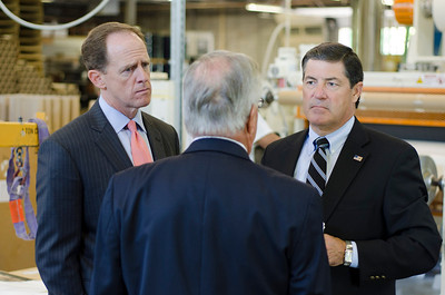 Senator Pat Toomey (left) and Congressman Jim Gerlach (right) speak with Thomas Krug, founder and president of Litetech Inc., about the effect of Medical Device Tax on small businesses.  Rick Kauffman/Times Herald Staff