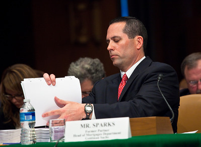 Daniel Sparks of Goldman Sachs reads through embarrassing emails at the Senate Permanent Subcommittee on Investigations on Capitol Hill in Washington DC on April 27, 2010. (Photo by Jeff Malet)