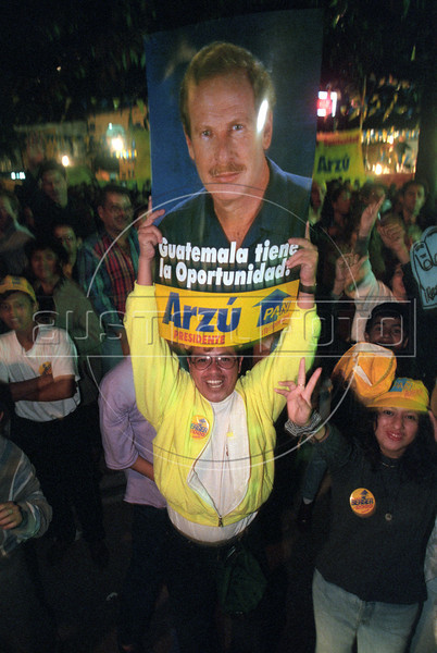 Supporters of Álvaro Enrique Arzú Yrigoyen celebrate his apparent victory over Alfonso Portillo in the January 1996 presidential runoff election. Arzú was President of Guatemala from January 14, 1996 until January 14, 2000. He has been elected Mayor of Guatemala City on four occasions: in 1982, but was prevented from assuming office because of a coup d'état; in 1986, this time assuming and serving his mandate; again in January 2004; and he was re-elected for a third effective term in September 2007. (Australfoto/Douglas Engle)