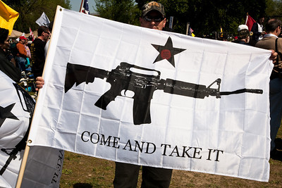 """""""Come and Take It"""". Gun rights activists gathered near the Washington Monument for the Second Amendment March on April 19, 2010. (Photo by Jeff Malet)"""