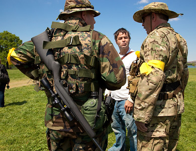 """Protestors come armed at the """"Restore the Constitution"""" gun rights rally at Gravelly Point Park on the Potomac River in Alexandria, VA. on April 19, 2010. (Photo by Jeff Malet)"""