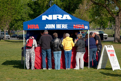 The NRA booth was busy as gun rights activists gathered near the Washington Monument for the Second Amendment March on April 19, 2010. (Photo by Jeff Malet)