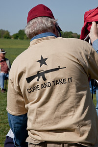 """Come and take it"". Gun rights activists gathered near the Washington Monument for the Second Amendment March on April 19, 2010. (Photo by Jeff Malet)"