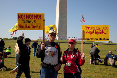 Invoking Charleton Heston, gun rights activists gathered near the Washington Monument for the Second Amendment March on April 19, 2010. (Photo by Jeff Malet)