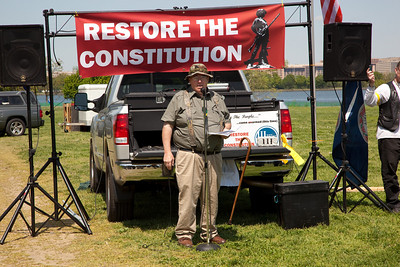 Mike Vanderboegh of Alabama, who allegedly advocated throwing bricks through the windows of Democrats who voted for the health-care bill, speaks at the Restore the Constitution gun rights rally at Gravelly Point Park on the Potomac River in Alexandria, VA on April 19, 2010. Many protestors came armed. (Photo by Jeff Malet)