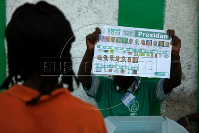 A man shows his vote at a polling station in Port au Prince, Haiti.(Australfoto/Nicolas Garcia)