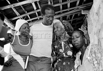 Gérard Pierre-Charles, Haitian politician, economist and former leader of the Unified Party of Haitian Communists, with actress Chantal, left, and mexican natives, during a haitian movie realisation in Oaxaca state, Mexico, February 7, 1982. (Austral Foto/Renzo Gostoli)