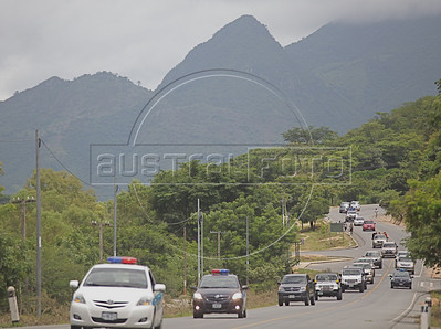 A caravan of vehicles of ousted Honduran President Manuel Zelaya and his supporters drivestowards the Hondura border from Ocotal, Nicaragua, 23 Km (14 miles), Sunday, July 26, 2009. (Australfoto Nicolas Garcia)