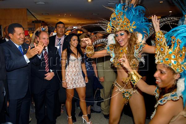 Venezuela's President Hugo Chavez, left, watch to samba dancers of Vila Isabel samba school; Vila Isabel wins the 2006 Rio Carnival, sponsored by the Venezuela's oil company PDVSA. Hugo Chavez participates at the Mercosul Summit in Rio de Janeiro, Brazil, January 18, 2007. (Austral Foto/Renzo Gostoli)