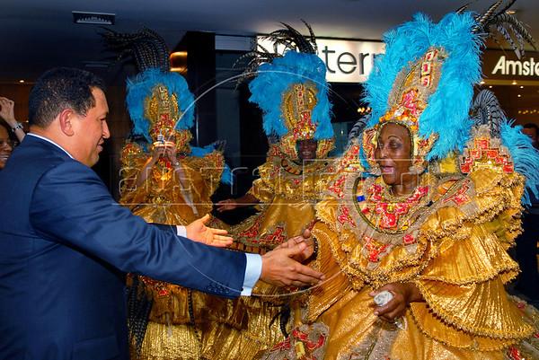 "Venezuela's President Hugo Chavez, left, greets ""bahianas"" of Vila Isabel samba school; Vila Isabel wins the 2006 Rio Carnival, sponsored by the Venezuela's oil company PDVSA. Hugo Chavez participates at the Mercosul Summit in Rio de Janeiro, Brazil, January 18, 2007. (Austral Foto/Renzo Gostoli)"
