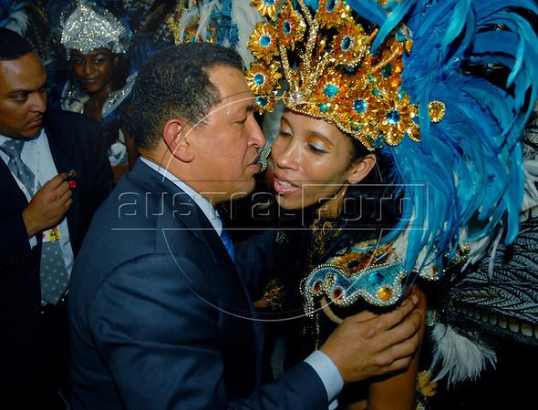 Venezuela's President Hugo Chavez, left, kisses a dancer of Vila Isabel samba school; Vila Isabel wins the 2006 Rio Carnival, sponsored by the Venezuela's oil company PDVSA. Hugo Chavez participates at the Mercosul Summit in Rio de Janeiro, Brazil, January 18, 2007. (Austral Foto/Renzo Gostoli)