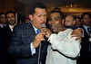 Venezuela's President Hugo Chavez, left, sings with Tinga, right, samba singer of Vila Isabel samba school; Vila Isabel wins the 2006 Rio Carnival, sponsored by the Venezuela's oil company PDVSA. Hugo Chavez participates at the Mercosul Summit in Rio de Janeiro, Brazil, January 18, 2007. (Austral Foto/Renzo Gostoli)
