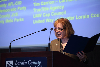Senator Gayle Manning reads a message from governor John Kasich at the 19th Annual Hispanic Leadership Conference. photo by Ray Riedel