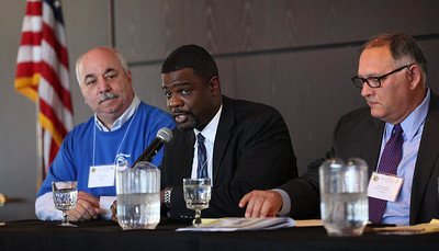 Todd Q. Adams, Chief Officer of Sustainability and Innovation, Visibility Marketing Inc., speaks about the value proposition of Immigration Reform in the panel discussion at the 19th Annual Hispanic Leadership Conference. On the left is Celestino Rivera, Lorain Chief of Police, on the right is Michael J. Rendon, private attorney with a specialty in immigration law. photo by Ray Riedel